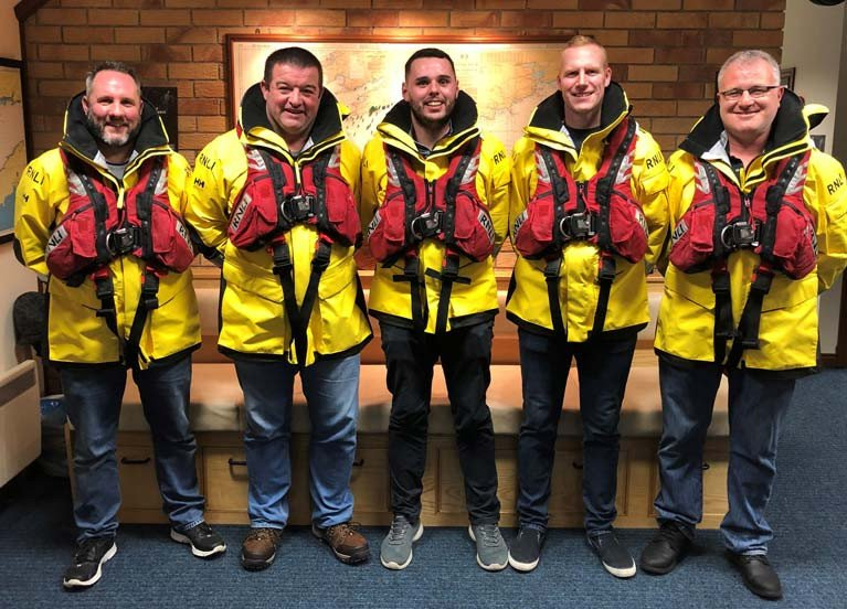 The lifeboat crew from Castletownbere who are to receive RNLI Gallantry Awards for a rescue. L – R: Lifeboat crewmember John Paul Downey, Lifeboat Mechanic Martin O'Donoghue, Coxswain Dean Hegarty, Lifeboat crewmember Dave Fenton and Lifeboat crewmember Seamus Harrington