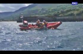 Red Bay RNLI's volunteer crew recover the stranded kayakers onto the inshore lifeboat