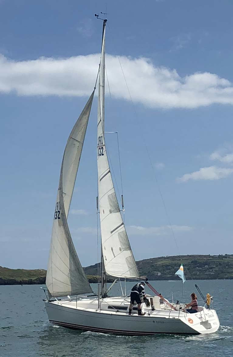 HYC Commodore Ian Byrne on the winch and Lea O'Donoghue maintaining social distance on the helm aboard the Commodore's Sunfast 32 Sunburn, all within 5 kilometres of home in the weekend's revival of sailing at Howth
