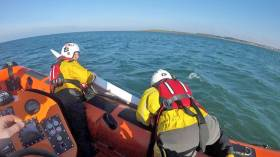 Bangor's lifeboat crew retrieving one of the paddleboards after Saturday's rescue