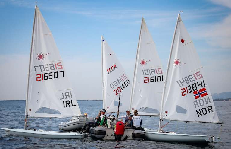 Ireland's Liam Glynn and Ewan McMahon raft up with competitors as they wait for wind in Follonica today at Italian Olympic Week
