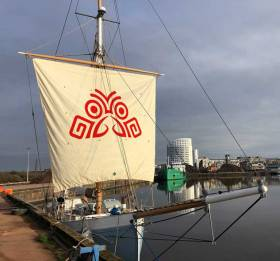 Symbol for a voyage – the Salmons Wake logo inscribed on Ilen's squaresail in the Ted Russell Dock in Limerick