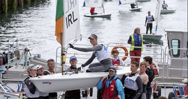 Silver medal winner Howth Yacht Club's Ewan McMahon is carried ashore at the Royal St. George Yacht Club in Dun Laoghaire