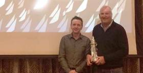Mark Mansfield (right) collects the boat of the year trophy from ICRA Commodore Simon  McGibney