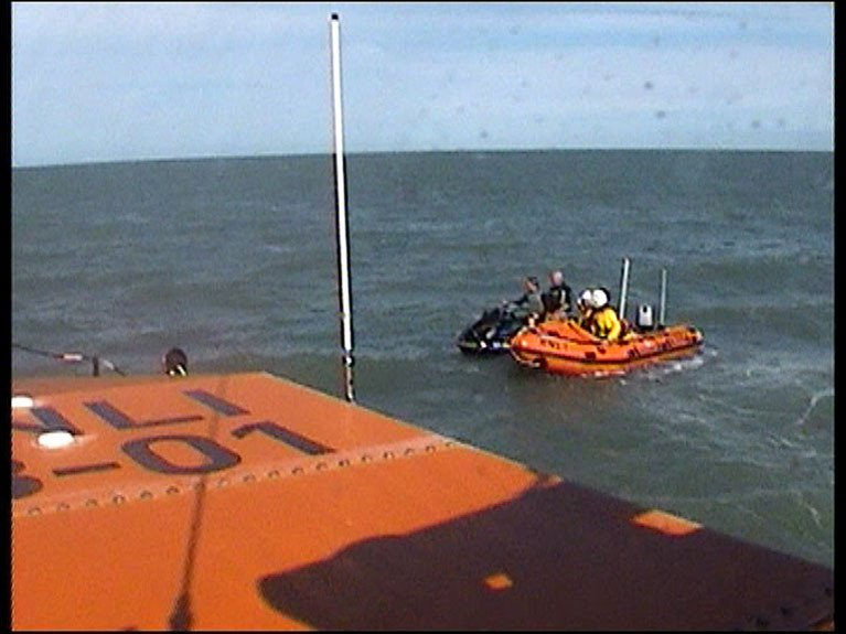 A video still of Wicklow all-weather lifeboat and Inshore lifeboat with the Jet ski off Brittas