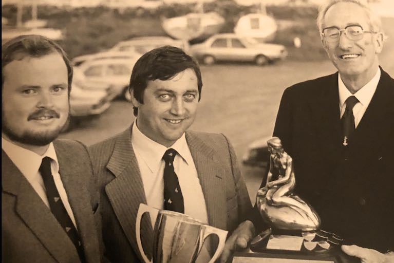 Mermaid Week 1982 at Galway Bay SC with (left to right) Pierce Purcell (GBSC), 1982 Champion Jim Dempsey (Skerries SC), and Mermaid Association President Michael Lysaght
