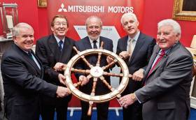 "The Ship's Wheel finds its new home for 2016. At the Mitsubishi Motors ""Sailing Club of the Year"" presentation to the Royal Irish Yacht Club this week were (left to right) David Lovegrove (President Irish Sailing Association), Afloat.ie's W M Nixon (adjudicator), James Horan (Commodore RIYC), Billy Riordan (Mitsubishi Motors, adjudicator) and Frank Keane (Chairman, Mitsubishi Motors)."