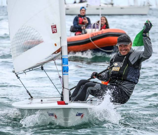 World Champion - NYC's Mark Lyttle sails home to Dun Laoghaire and a hero's welcome after the conclusion of the Laser Master Worlds on Dublin Bay