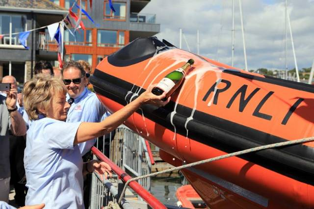 Fundraising chair Valerie Good names the new lifeboat in the traditional manner