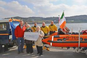 Clifden RNLI members Andrew Bell, Ciaran Folan, David Coyne, Barry Ward and John Brittain accept a cheque for €1,820 from Jacqueline Hannon and Nancy Duffy on St Patrick's Day