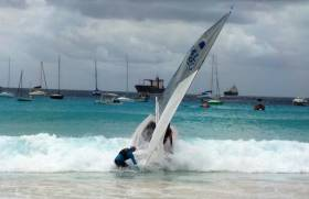A GP14 is launched off the beach at Barbados Yacht Club in the build up to the World Championships on Monday. 23 Irish boats are competing.