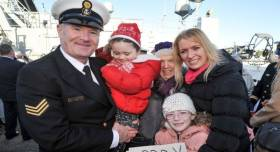 Bosun Gerry Dore is welcomed home yesterday by wife Geraldine and his daughters and mother-in-law at Haubowline Naval Base, Cork Harbour