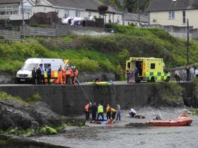 The injured cyclist is winched from the Strand at Wicklow Harbour to a waiting ambulance