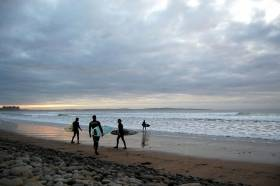 Surfers at Doonbeg, Co Clare