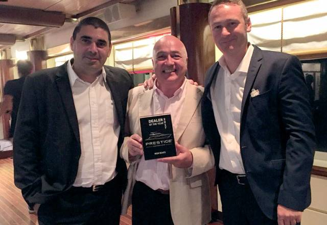MGM Boats John O'Kane (centre) with the 'Dealer of the Year' award and Jeanneau executives (left) Jean-Philippe Brun, European sales director and Jean-Paul Chapeleau, Jeanneau CEO at the dealer conference in Turkey