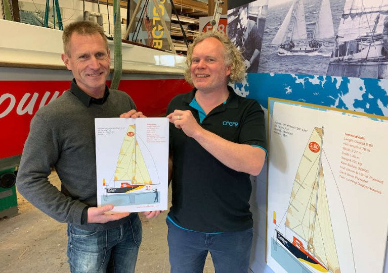 ClassMini 5.80 Association founding board member Eli Van der Broke hands over the licence of prototype Mini 5.80 number 02 to Michiel Pals at Kolibri Yachtbuilders in the Netherlands