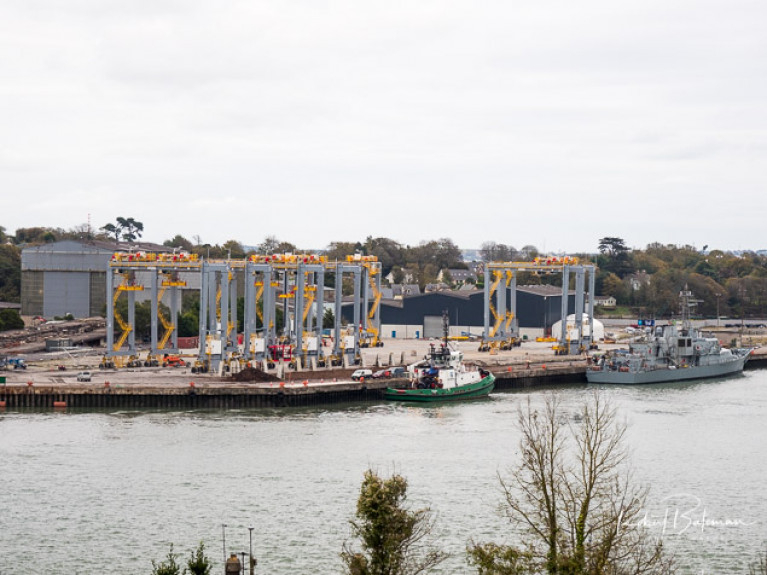 Crane assembly for Somaliland at Cork Dockyard with both a Cork Harbour tug and the Navy's LE Niamh alongside
