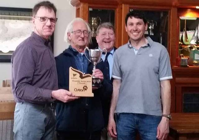 Jeff Condell and Jeff Cochrane of Fuggles accepting the Squib Trophy from Kinsale Yacht Club Commodore Dave Sullivan and Bruce Matthews