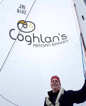 Skipper Brendan Coghlan with his new spinnaker and the sponsors graphic applied by North Sails Ireland