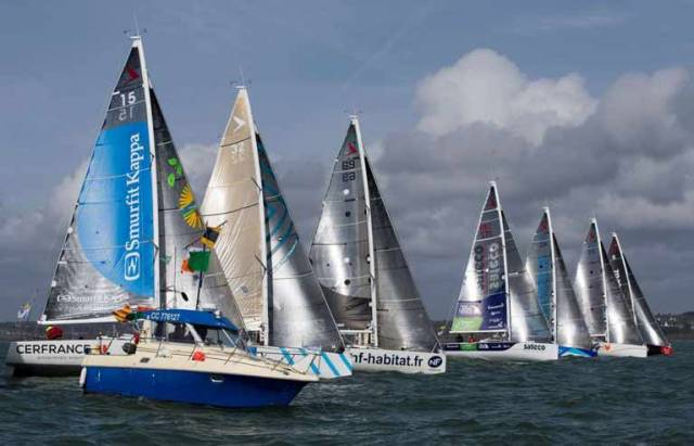 The sponsors get their moneysworth at the start – Tom Dolan and Tanguy Bouroullec with Smurfit Kappa-Cerfrance put themselves right in the picture as racing gets under way in the Concarneau 250 for the Guy Cotten Trophy
