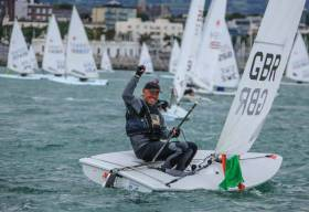 World Champion - NYC's Mark Lyttle sails home to Dun Laoghaire and a hero's welcome after the conclusion of the Laser Master Worlds on Dublin Bay Photo: Afloat.ie