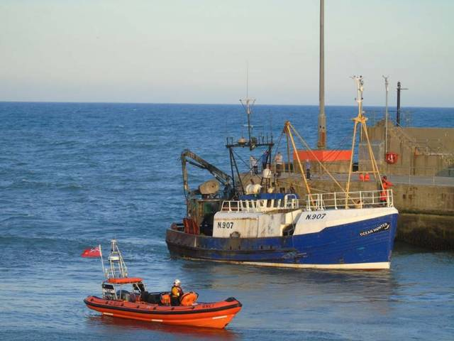 Kilkeel RNLI alongside the fishing boat which reported an ill crew member yesterday evening