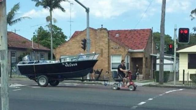 A photo of the man driving down the Pacific Highway on a motorised scooter was widely shared on social media.
