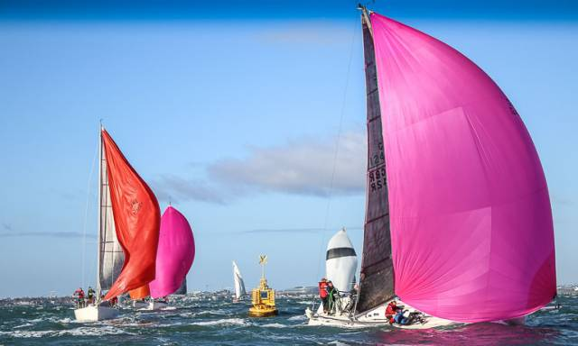 Richard Goodbody's White Mischief (pink spinnaker) leads J109 sistership Joker II (Richard Maybury) at the gybe mark of last week's opening Turkey Shoot Race on Dublin Bay