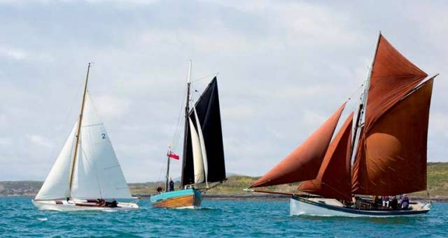 It's early summer in West Cork, and time for the Baltimore Wooden Boat Festival's eclectic collection of timber craft to show their style. Typical of the mix are (left to right) Kevin O'Farrell's Scottish Islands Class Mylne-designed McGruer-built sloop Canna, the Falmouth-based Dandy type Lively (James Baker), and the Mackerel Boat An Run (Nigel Towse, sailed by Ian Wright)