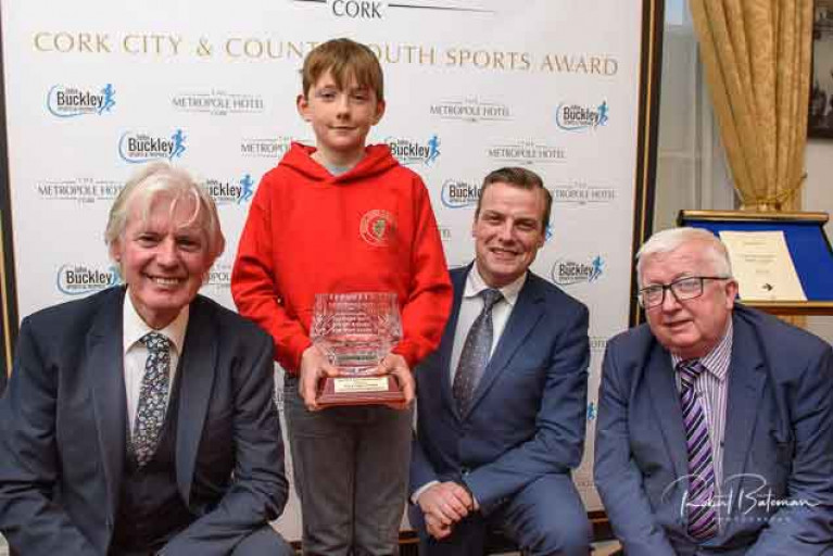 Nine-year-old Olin Bateman collects his award from the judges