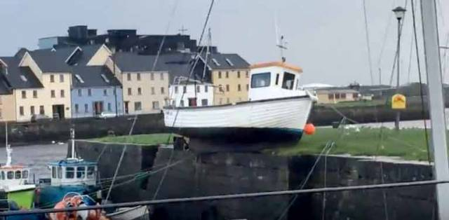 Galway Bay SC sailor Aaron O'Reilly sent us this brief video of the clinker-built fishing boat which ended up perilously balanced – but miraculously secured – right on top of the pier across the Corrib from the Claddagh