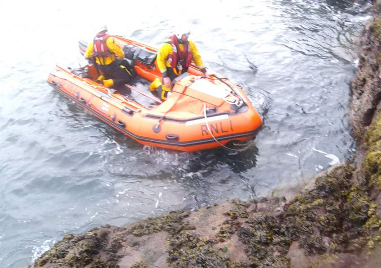 Larne RNLI's inshore lifeboat Terry at the cliff near Muck Island