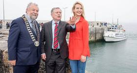 Actress Aoibhinn Garrihy whose family run Doolin2Aran Ferries at Doolin Pier Co Clare shares her local knowledge with Minister Brendan Howlin and Cathaoirleach of Clare County Council John Crowe during the Official opening of the new €6m Pier at Doolin, Co. Clare, by Brendan Howlin, T.D., Minister for Public Expenditure & Public Reform earlier this year