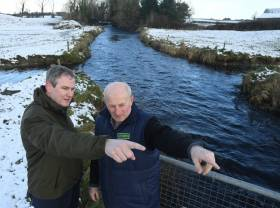 Minister Sean Kyne with local landowner Pat Ward, viewing the Grange River developments at the launch of funding for community-based angling conservation projects