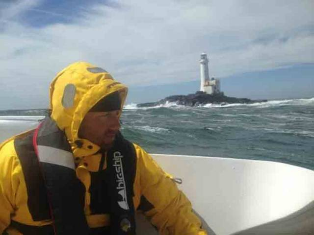 A competitor in the Class 40 Normandy Channel Race at the Fastnet Rock off the Cork coast