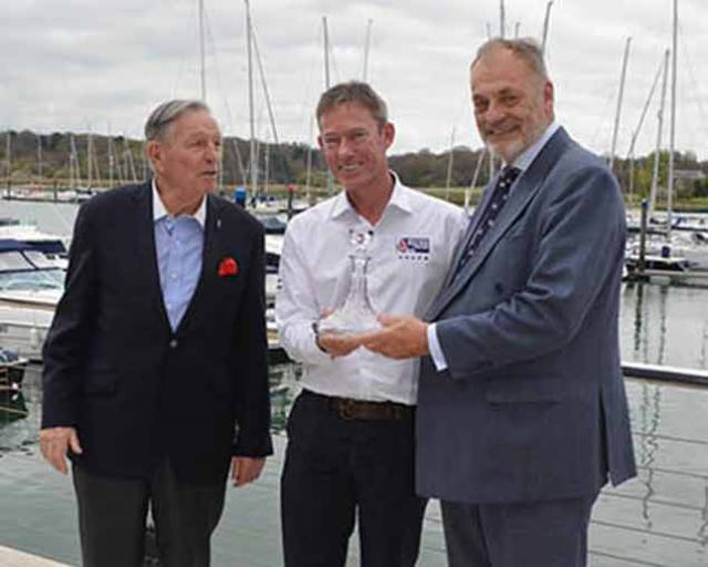 Stephen 'Sparky' Park is presented with a boats.com/YJA Special Award for services to the sport of sailing at the Royal Southern Yacht Club Hamble this week. The award was presented by Barry Pickthall, Chairman of the Yachting Journalists' Association (right) and former Chairman Bob Fisher.