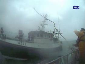 The Dunmore East RNLI crew throws a towline to the stricken trawler