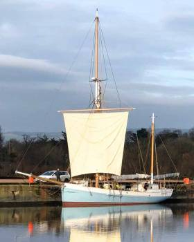 The jaunty look. Miraculous mid-winter calm for the first setting of Ilen's new squaresail in the dock at Limerick