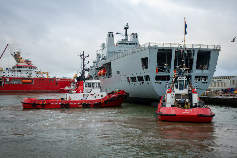 The UK's Royal Fleet Auxiliary replenishment supplies and fuel tanker RFA Fort Victoria following a 30 year Special Survey dry-docking at Cammell Laird shipyard in Birkenhead on Merseyside. AFLOAT also adds pictured in the facilities non-tidal wet basin is the newbuild scientific research vessel RRS Sir David Attenborough.
