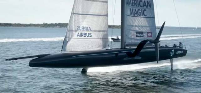 The first of American Magic's two AC75's is officially named DEFIANT in front of friends and family during a ceremony at the team's base of operation in Portsmouth, Rhode Island.