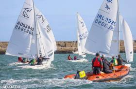 All Ireland competitors are observed by on the water umpires as they race downwind at the championships that was sailed inside Dun Laoghaire Harbour
