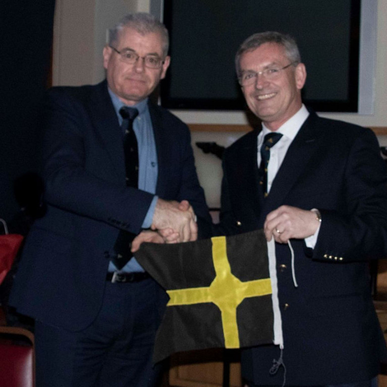 New MYC Commodore Daniel Flavin receives his pennant from predecessor Matt Ryan at the club's recent AGM