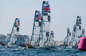Team GB's Charlotte Dobson and Dun Laoghaire's Saskia Tidey (pictured centre, GBR 10) lead the fleet into a weather mark with Ireland's Annalise Murphy and Katie Tingle (left)