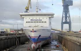 One of the Stena vessels in dry dock at H&W Belfast, which AFLOAT adds is Stena Lagan, the first of a pair that operates Belfast-Birkenhead (Liverpool) is docked for works. During the refit programme, Stena Horizon from the Rosslare-Cherbourg route is covering in for the dry-dockings. In turn Stena Nordica operates the French route in addition freight-only Stena Forerunner (of Liverpool route) last weekend provided a boost in capacity given Irish Ferries reduced sailing frequency of recent months based out of Dublin. Also above behind the gangway is Stena Forerunner, which Afloat last year covered in its deployment from North Sea service.