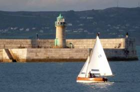 Making history. David & Sally MacFarlane sailing the 107-year-old Moosmie on their way to winning the first Water Wag race with a fleet of more than thirty boats, with Dun Laoghaire Harbour's wonderful stonework looking its classic best