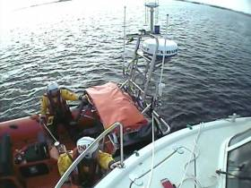 The lifeboat crew set up for tow and eased the cruiser off the rocks and into safe water