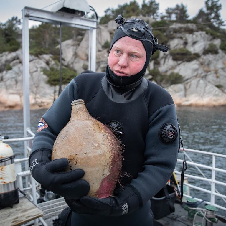 A diver with a bottle from the Irish Sailing Ship 'Providentz' that sank in Norway in 1720