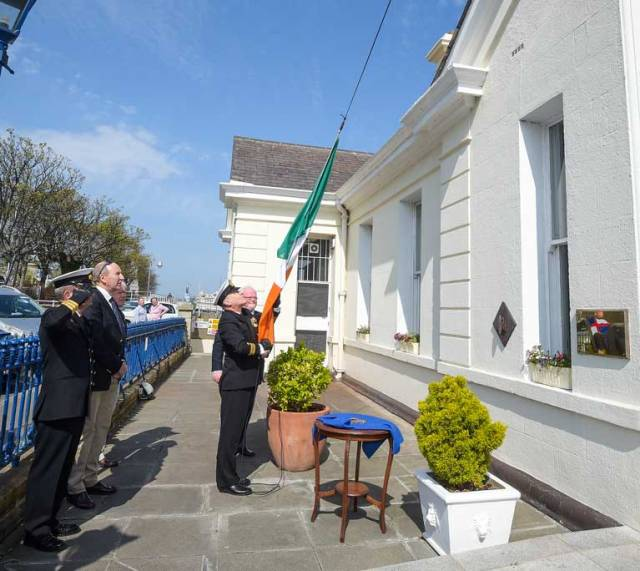 Lieutenant Commander Murphy raises the Tricolour at the National Yacht Club. The NYC commemorated the 70th anniversary of the Republic of Ireland with a special flag hoisting ceremony