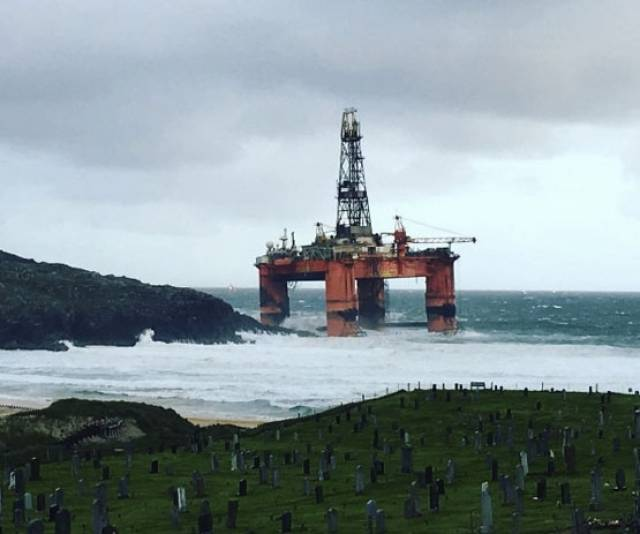 The drilling rig Transocean Winter leans on the beach at Dalmore on Lewis after blowing ashore in high winds