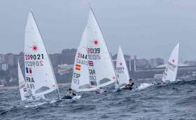 Finn Lynch among a group of Lasers at the first day of the Sailing World Cup Final in Santander